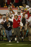 Jim Tressel runs on to the field as time expires at Fiesta Bowl in Tempe, AZ.