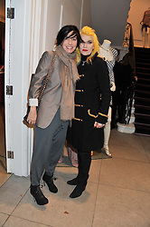 Left to right, SHARLEEN SPITERI and PAM HOGG at a party to celebrate the switching on of the Christmas Lights at the Stella McCartney store, Bruton Street, London on 29th November 2011.