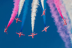 © Licensed to London News Pictures. 12/07/2014. RAF Fairford UK. The RAF Red Arrows Display Team Performs at the Royal International Air Tattoo at RAF Fairford. Photo credit : Ian Schofield/LNP