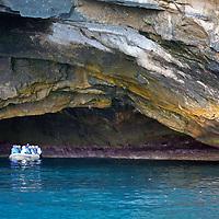 South America, Ecuador, Galapagos Islands. A zodiac explores Punta Vicente Roca lava cave.