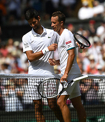LONDON, ENGLAND - Monday, July 1, 2019: Novak Djokovic (SRB) shakes hands with opponent Philipp Kohlschreiber (GER) (R) after winning his opening match during the Gentlemen's Singles first round match on Day One of The Championships Wimbledon 2019 at the All England Lawn Tennis and Croquet Club. (Pic by Kirsten Holst/Propaganda)