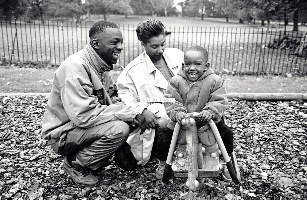 Young family in the park, Nottingham UK 1992