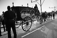 Aug 29, 2008, New Orleans, LA, A coffin arrives atthe Charity Hospital Cemetery in New Orleans on the  three Year Anniversary of Hurricane Katrina. At the memorial seven unidentified people who died during Katrina were interred.