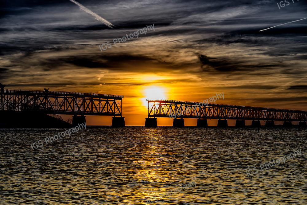 Contrails at Sunset over the Broken Bridge at Bahia Honda State Park