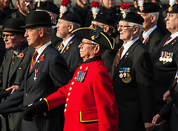 Veterans process past the Cenotaph memorial during the annual Remembrance Sunday Service in Whitehall, central London, held in tribute for members of the armed forces who have died in major conflicts.