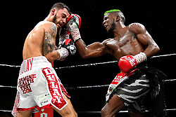 April 13, 2018 - Minnesapolis, MN, USA - Chris Colbert, of Brooklyn, connects with an uppercut against Austin Dulay, of Nashville, Tenn., during their lightweight match at the Armory in Minneapolis on Friday, April 13, 2018. (Credit Image: © Aaron Lavinsky/TNS via ZUMA Wire)