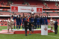 Football - 2019 Emirates Cup - Arsenal vs. Lyon<br /> <br /> Olympique Lyonnais' Memphis Depay lifts the trophy after their 2-1 victory, at the Emirates Stadium.<br /> <br /> COLORSPORT/ASHLEY WESTERN