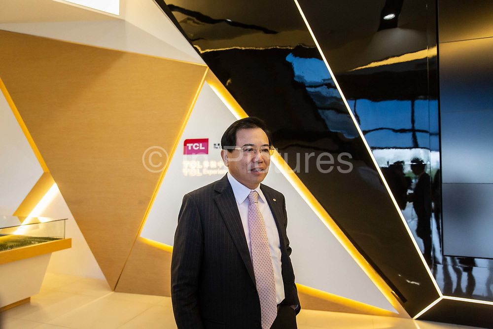Li Dongsheng, chairman and chief executive officer of TCL Corp., attends a news conference at the companys headquarters in Huizhou, Guangdong province, China, on Monday, April 18, 2016. Once synonymous with Chinas manufacturing might, as the days of cheap land and labor recede, the provinces businesses are in a race to upgrade or move.