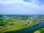 """Nederland, Overijssel, Gemeente Kampen; 21–06-2020; zicht op de IJssel en de Onderdijkse Waard, Kampen in de achtergrond met het inlaatwerk van het nieuw aangelegde Reevediep, Het Lange End.<br /> Het Reevediep is aangelegd in het kader van het project Ruimte voor de Rivier om bij hoogwater water af te voeren voordat dit het nabij gelegen Kampen bereikt, direct naar het IJsselmeer, de 'bypass Kampen'. Het Reevediepgebied is ook een natuurgebied en vormt een ecologische verbindingszone tussen rivier de IJssel en Drontermeer.<br /> View of river IJssel with the Onderdijkse Waard, Kampen city in the background. The newly constructed inlet of the Reevediep, The Long End.<br /> The Reevediep has been constructed as part of the Room for the River project, and functions to discharge high waters before reaching the nearby Kampen, directly to the IJsselmeer, the """"bypass Kampen"""". The Reevediep area is also a nature reserve and forms an ecological connecting zone between the river IJssel and Drontermeer.<br /> <br /> luchtfoto (toeslag op standard tarieven);<br /> aerial photo (additional fee required)<br /> copyright © 2020 foto/photo Siebe Swart"""