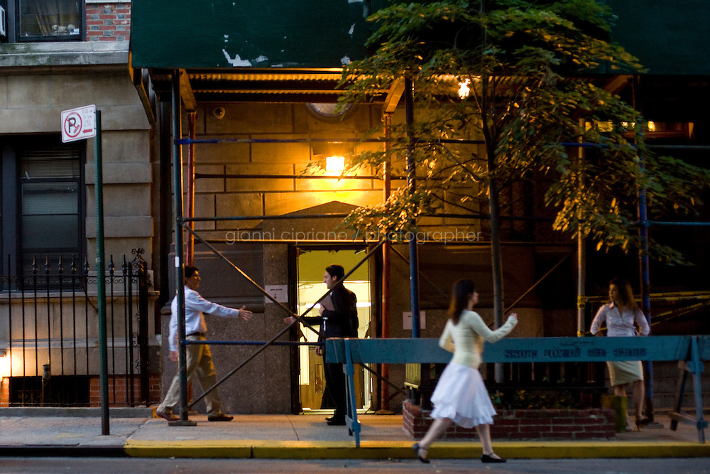 1 August, 2008. New York, NY. Young orthodox men and women gather in front of the Ohab Zedek Synagogue on a Friday evening, before the beginning of the Shabbat service. The Ohab Zedek is one of the main loci of young Orthodox singles. <br />  ©2008 Gianni Cipriano for The New York Times<br /> cell. +1 646 465 2168 (USA)<br /> cell. +1 328 567 7923 (Italy)<br /> gianni@giannicipriano.com<br /> www.giannicipriano.com