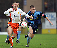 Photo:  Frances Leader.Digitalsport<br /> Wycombe wanderers v Mansfield Town. The Coca-Cola Football League two. Causeway Stadium.<br /> 23/10/2004<br /> Mansfield's Craig Woodman and Wycombe's Tony Craig chase the ball.