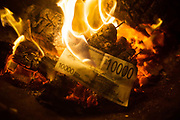 A 10000 Heaven Bank note - Chinese New Year fake money on fire.