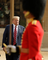 US President Donald Trump inspects a Guard of Honour, formed of the Coldstream Guards, at Windsor Castle, Windsor.