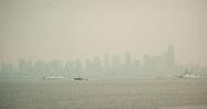 2018 AUGUST 20 - Smoke fills the skies of Seattle, WA, USA. Seen from near Don Armeni Boat Ramp in West Seattle. By Richard Walker