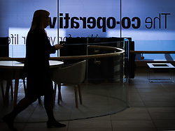 © Licensed to London News Pictures . FILE PICTURE DATED 14/11/2013 . Manchester , UK . A woman in a suit crosses the main foyer of the Co-operative's new corporate HQ at 1 Angel Square . The chairman of the Co-operative Group , Len Wardle , has resigned after a sex and drugs scandal involving the group's former banking chairman , Paul Flowers . Queen Elizabeth II and the Duke of Edinburgh visit the Coop building at 1 Angel Square , Manchester , this morning ( 14th November 2013 ) . Photo credit : Joel Goodman/LNP