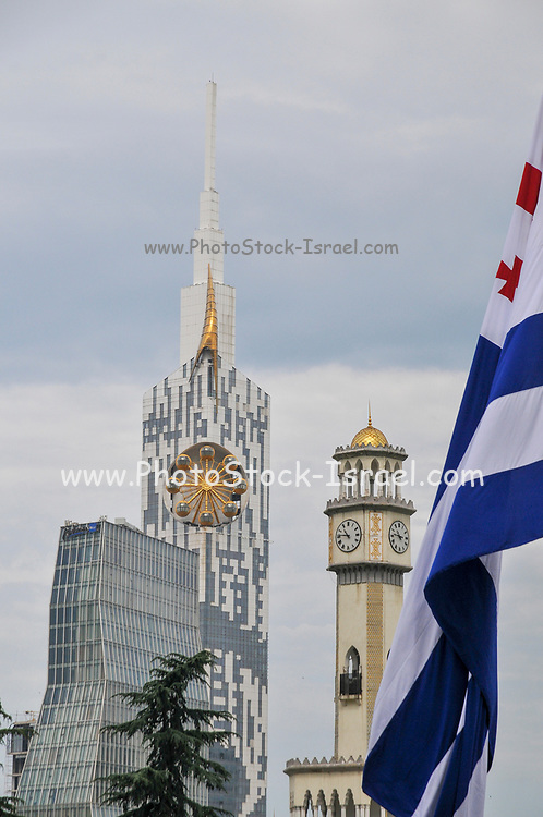 Old Clock Tower and Technological University tower with a Georgian flag in the foreground in Miracle Park, on the Black Sea coast in Batumi, Georgia