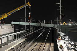 Night Bridge Steel Pick over Northeast Corridor Tracks. Construction of the Railroad Station at Fairfield Metro Center, Connecticut.
