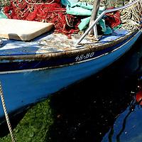 Blue empty boat in Bol Harbour; <br />Bol, Brac, Croatia.
