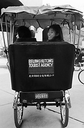 Japanese schoolgirls on a rickshaw tour of Beijing hutongs