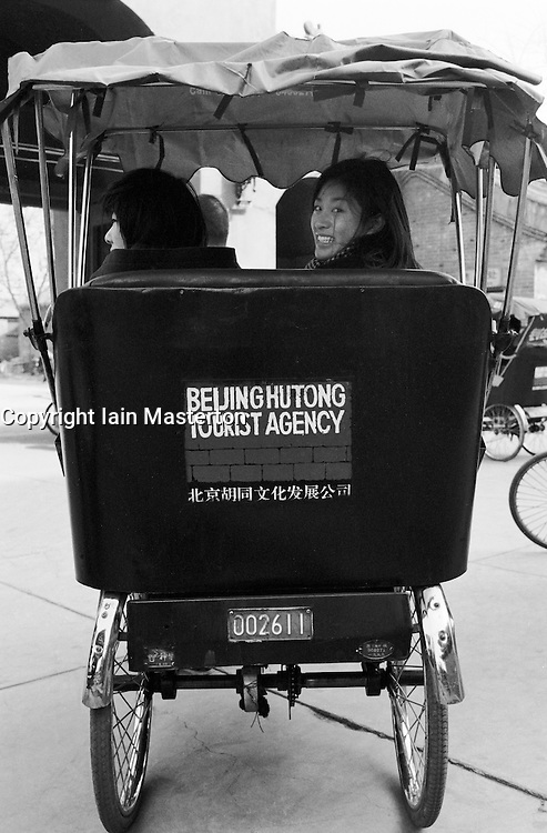 Japanese schoolgirls on a rickshaw tour of Beijing hutongs