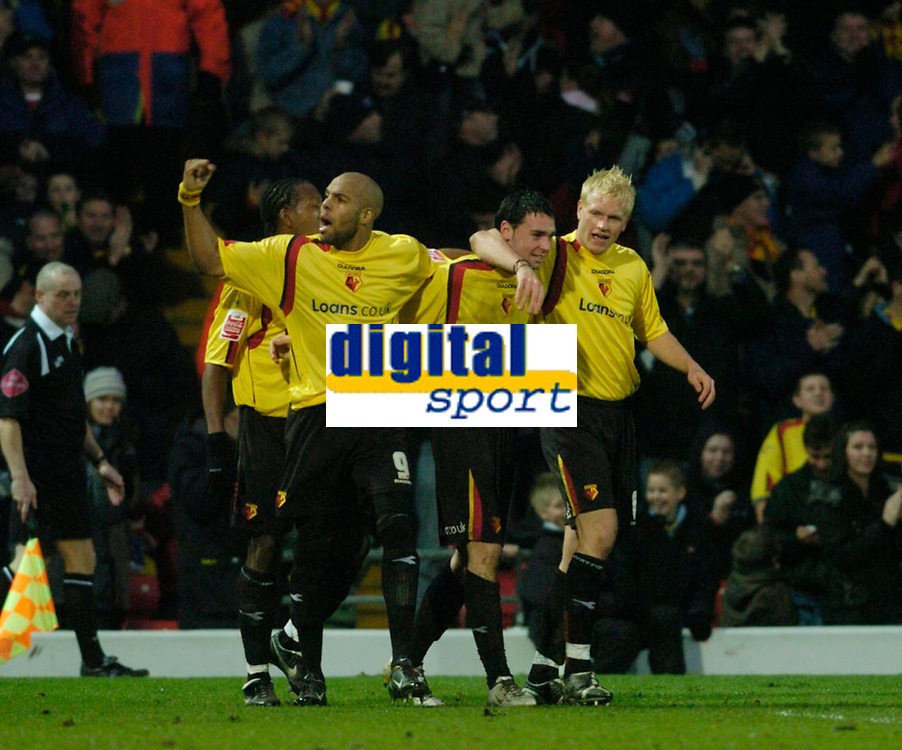 Photo: Leigh Quinnell.<br /> Watford v Stoke City. Coca Cola Championship.<br /> 14/01/2006. Watfords Marlon King(L) and Jay De Merit(R) help Chris Eagles celebrate his goal.