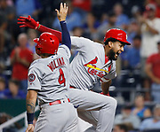 St. Louis Cardinals' Jose Martinez, right, celebrates with Yadier Molina, left, after hitting a two-run home run in the ninth inning of a baseball game against the Kansas City Royals at Kauffman Stadium in Kansas City, Mo., Saturday, Aug. 11, 2018. The Cardinals beat the Royals 8-3. (AP Photo/Colin E. Braley)