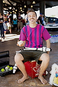 HOT SPRINGS, AR – JUNE 29, 2013: A clown performs at the weekly farmer's market.
