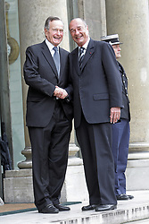 President Jacques Chirac receives former US President George Bush at the Elysee Palace in Paris, France, on May 1st, 2006. Photo by Mehdi Taamallah/ABACAPRESS.COM