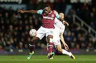 Michail Antonio of West Ham United and Kevin Stewart of Liverpool compete for the ball. The Emirates FA cup, 4th round replay match, West Ham Utd v Liverpool at the Boleyn Ground, Upton Park  in London on Tuesday 9th February 2016.<br /> pic by John Patrick Fletcher, Andrew Orchard sports photography.