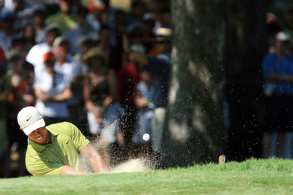 11 August 2007: Tiger Woods blasts out of the green-side bunker on the 8th hole during the third round of the 89th PGA Championship at Southern Hills Country Club in Tulsa, OK.