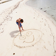 Happy beach, happy child concept photography, photographed in the Cayman Islands.