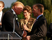 Oct. 04, 2011 - Charlottesville, VA. USA; Donald Trump shakes hands with Virginia Governor Bob McDonnell during a press conference announcing the grand opening of Trump Vineyard Estates Tuesday in Charlottesville, Va. Trump purchased the foreclosed vineyard, previously owner by Patricia Kluge, at auction earlier this year. The 2,000 acre Trump Vineyard estate is also the home to Trump Winery, helmed by Donald's son Eric Trump.  (Credit Image: © Andrew Shurtleff)
