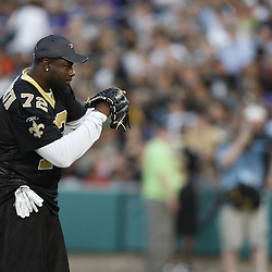 Apr 28, 2010; Metairie, LA, USA; Tim Duckworth (72) pitches during the Heath Evans Foundation charity softball game featuring teammates of the Super Bowl XLIV Champion New Orleans Saints at Zephyrs Field.  Mandatory Credit: Derick E. Hingle-US-PRESSWIRE.