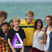James O' Connor poses for photographs with locals during the Australian teams recovery session at  Takapuna Beach at the IRB Rugby World Cup tournament, Auckland, New Zealand, 17th October 2011. Photo Tim Clayton...