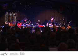 In this intricately choreographed performance, multi-instrumentalists Daniel Holdsworth and Aidan Roberts frantically juggle pianos, organs, electric guitars, acoustic, bass and Spanish guitars, mandolin, tuned percussion, drums, glockenspiel, loop pedals, synthesizers and, of course, tubular bells.