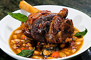 Food specialties created by the talented and creative Chef Jason Dodge at Peche Restaurant and Bar. Applewood Smoked and Braised Niman Ranch Lamb Shank with White Bean Cassoule. A Jason Dodge dish, Peche Restaurant and Bar, Austin, Texas