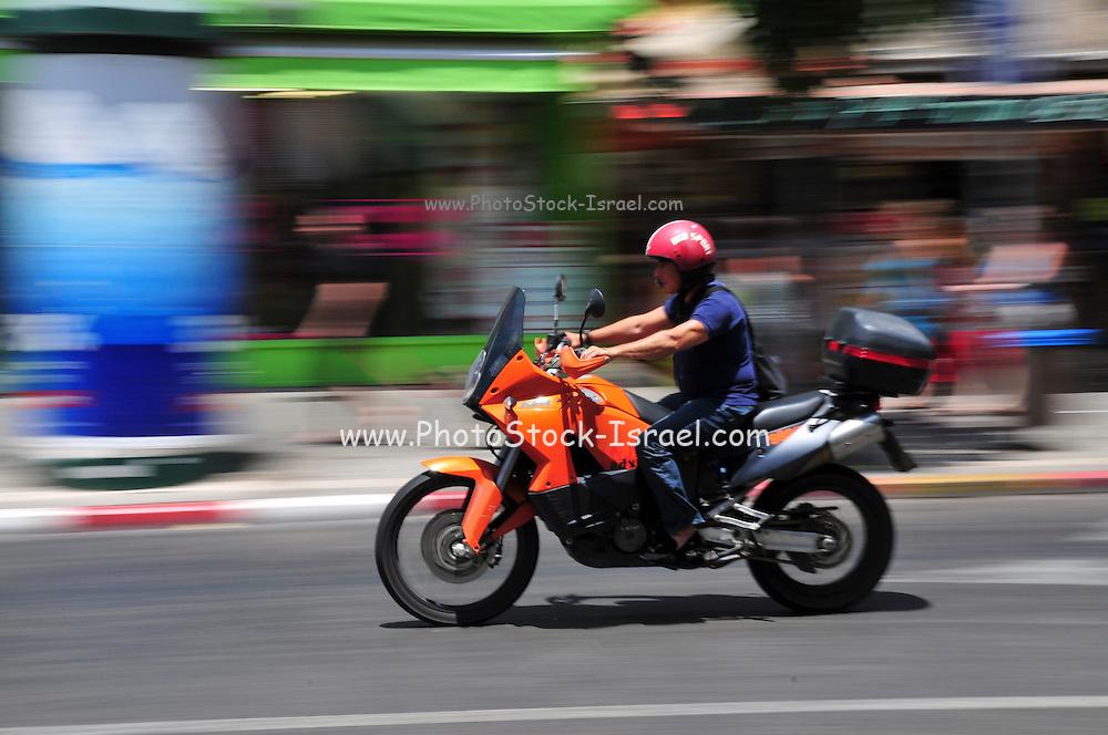 Israel, Tel Aviv, King George street motorbike speeds down the street