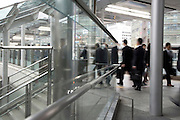 businessmen walking through a modern outdoor corridor