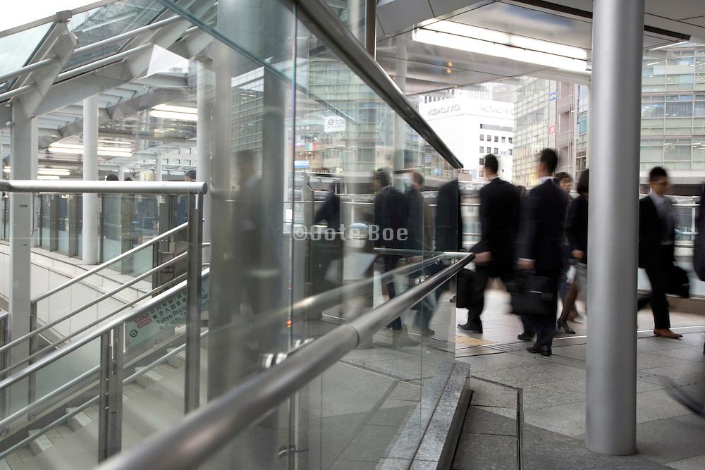 businessmen walking through a modern outdoor corridor