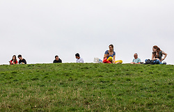 © Licensed to London News Pictures. 09/09/2020. London, UK. Members of the public enjoy the views from Primrose Hill in North London as Health Minister Matt Hancock announced that from Monday a social gathering of more than six people will be illegal in England and enforced with a £100 fine after a surge of positive Covid19 cases. Earlier Labour Leader Keir Starmer blasted Prime Minister Boris Johnson during PMQs over the handling of the UK's testing program and pointed out that many people weren't able to get a test near their homes and were being told to travel miles to get one. Photo credit: Alex Lentati/LNP