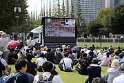 Spectators watch the Marathon Grand Championship on a video screen, Sunday Sept. 15 2019, in Tokyo. (Agence SHOT/Image of Sport via AP)