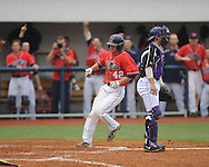 Ole Miss' Holt Perdzock (42) scores in the 7th inning vs. Lipscomb's Taylor Stewart at Oxford-University Stadium in Oxford, Miss. on Sunday, March 10, 2013. Ole Miss won 9-8. The Rebels improve to 16-1.