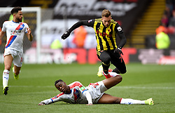 Watford's Gerard Deulofeu (right) and Crystal Palace's Aaron Wan-Bissaka battle for the ball
