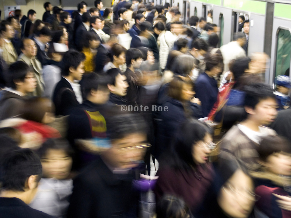 evening rush hour commuters Tokyo Japan