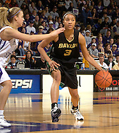 Baylor guard Jessica Morrow (R) drives against pressure from Kansas State's Claire Coggins (L), during the first half at Bramlage Coliseum in Manhattan, Kansas, February 25, 2006. The 10 ranked Lady Bears defeated K-State 79-70.