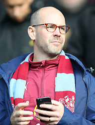Burnley fan in the stands at the Leicester City v Burnley match