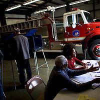 """Walterboro, SC - FEBRUARY 20:  Erica Levine, 20, a poll manager at the Colleton County Fire & Rescue polling precinct registers a voter in Walterboro, SC, on February 20, 2016.  Statewide voters will cast ballots today in the South Carolina Republican Presidential Primary, the """"first in the south.""""  (Photo by Mark Makela/Getty Images)"""