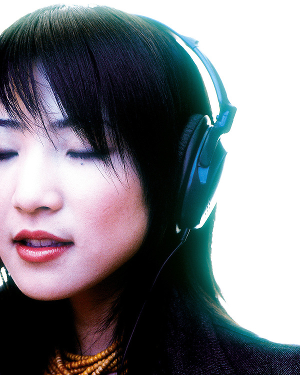 Portrait of an asian girl with headphones