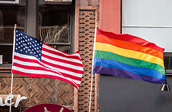 July 29, 2017 - New York City, New York, United States of America - The LGBTQ Pride flag and the United States flags flown together in NYC. (Credit Image: © Sachelle Babbar via ZUMA Wire)