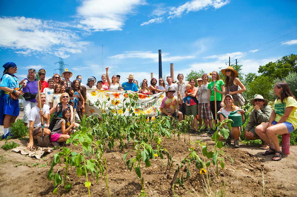 Activists plant a garden patch of sunflowers in front of the coal-fired Valmont Power Plant in Boulder, Colorado to protest its continued operation. The all-ages group reached the site by riding bicycles from downtown.